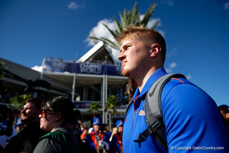 Florida Gators quarterback Kyle Trask (11) as the Gators walk into Camping World Stadium during Gator Walk as the University of Florida Gators prepare to take on the University of Miami Hurricanes at Camping World Stadium in Orlando, Florida.  August 23rd, 2019. Gator Country Photo by David Bowie.