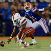 Miami Hurricanes running back DeeJay Dallas (13) picks up a loose fumble as the University of Florida Gators hold on to win 24-20 over the University of Miami Hurricanes at Camping World Stadium in Orlando, Florida.  August 23rd, 2019. Gator Country Photo by David Bowie.