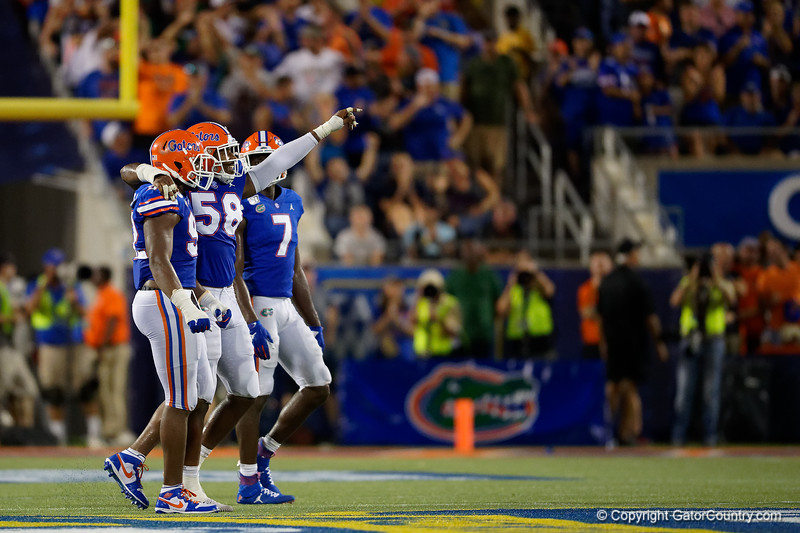 Florida Gators linebacker Jonathan Greenard (58) celebrates after the Gators defense stopped Miami on 4th down as the University of Florida Gators hold on to win 24-20 over the University of Miami Hurricanes at Camping World Stadium in Orlando, Florida.  August 23rd, 2019. Gator Country Photo by David Bowie.