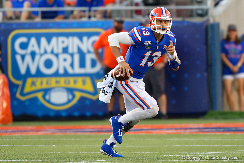 Florida Gators quarterback Feleipe Franks (13) scrambles out of the pocket as the University of Florida Gators hold on to win 24-20 over the University of Miami Hurricanes at Camping World Stadium in Orlando, Florida.  August 23rd, 2019. Gator Country Photo by David Bowie.
