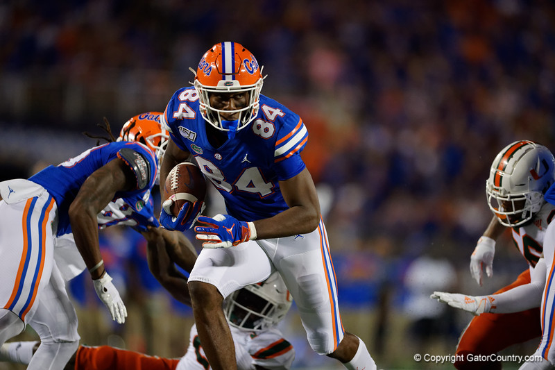 Florida Gators tight end Kyle Pitts (84) makes a catch and turns upfield as the University of Florida Gators hold on to win 24-20 over the University of Miami Hurricanes at Camping World Stadium in Orlando, Florida.  August 23rd, 2019. Gator Country Photo by David Bowie.
