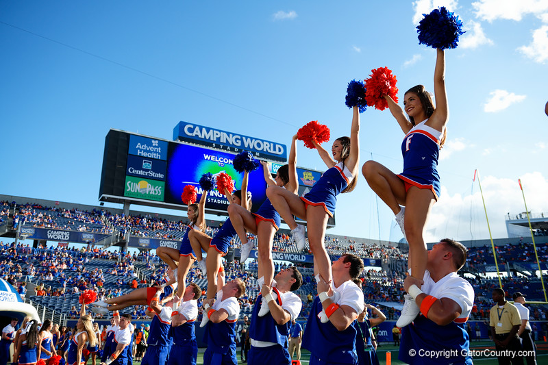 The Florida Gators cheerleaders cheer on during pregame as the University of Florida Gators hold on to win 24-20 over the University of Miami Hurricanes at Camping World Stadium in Orlando, Florida.  August 23rd, 2019. Gator Country Photo by David Bowie.