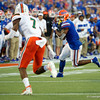 Florida Gators running back Lamical Perine (2) makes a catch as the University of Florida Gators hold on to win 24-20 over the University of Miami Hurricanes at Camping World Stadium in Orlando, Florida.  August 23rd, 2019. Gator Country Photo by David Bowie.