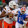 Miami Hurricanes quarterback Jarren Williams (15) rolls out of the pocket as the University of Florida Gators hold on to win 24-20 over the University of Miami Hurricanes at Camping World Stadium in Orlando, Florida.  August 23rd, 2019. Gator Country Photo by David Bowie.