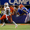 Miami Hurricanes quarterback Jarren Williams (15) scrambles with Florida Gators defensive back Trey Dean III (21) chasing as the University of Florida Gators hold on to win 24-20 over the University of Miami Hurricanes at Camping World Stadium in Orlando, Florida.  August 23rd, 2019. Gator Country Photo by David Bowie.