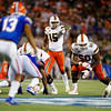 Miami Hurricanes quarterback Jarren Williams (15) at the line of scrimmage as the University of Florida Gators hold on to win 24-20 over the University of Miami Hurricanes at Camping World Stadium in Orlando, Florida.  August 23rd, 2019. Gator Country Photo by David Bowie.