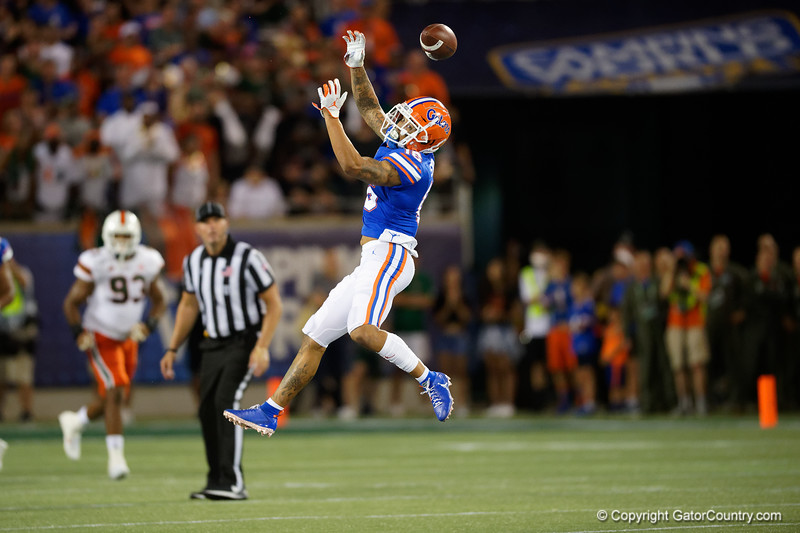 Florida Gators wide receiver Freddie Swain (16) leaps into the air but misses the ball, tips the ball into air and leads to an interception as the University of Florida Gators hold on to win 24-20 over the University of Miami Hurricanes at Camping World Stadium in Orlando, Florida.  August 23rd, 2019. Gator Country Photo by David Bowie.