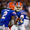 Florida Gators quarterback Feleipe Franks (13) turns and hands off the ball to Florida Gators running back Lamical Perine (2) as the University of Florida Gators hold on to win 24-20 over the University of Miami Hurricanes at Camping World Stadium in Orlando, Florida.  August 23rd, 2019. Gator Country Photo by David Bowie.