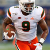Miami Hurricanes tight end Brevin Jordan (9) rushes for a first down as the University of Florida Gators hold on to win 24-20 over the University of Miami Hurricanes at Camping World Stadium in Orlando, Florida.  August 23rd, 2019. Gator Country Photo by David Bowie.