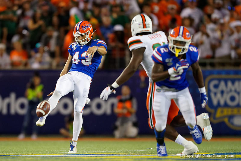 Florida Gators punter Tommy Townsend (43) punting as the University of Florida Gators hold on to win 24-20 over the University of Miami Hurricanes at Camping World Stadium in Orlando, Florida.  August 23rd, 2019. Gator Country Photo by David Bowie.
