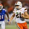 Miami Hurricanes place kicker Bubba Baxa (21) scrambles downfield on a fake punt as the University of Florida Gators hold on to win 24-20 over the University of Miami Hurricanes at Camping World Stadium in Orlando, Florida.  August 23rd, 2019. Gator Country Photo by David Bowie.