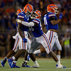 Florida Gators linebacker Jonathan Greenard (58) hugs Florida Gators linebacker Jeremiah Moon (7) in celebration as the University of Florida Gators hold on to win 24-20 over the University of Miami Hurricanes at Camping World Stadium in Orlando, Florida.  August 23rd, 2019. Gator Country Photo by David Bowie.