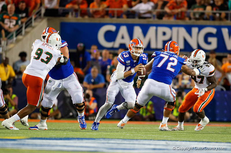 Florida Gators quarterback Feleipe Franks (13) scrambling as the University of Florida Gators hold on to win 24-20 over the University of Miami Hurricanes at Camping World Stadium in Orlando, Florida.  August 23rd, 2019. Gator Country Photo by David Bowie.