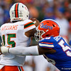 Florida Gators linebacker Jonathan Greenard (58) sacks Miami Hurricanes quarterback Jarren Williams (15) as the University of Florida Gators hold on to win 24-20 over the University of Miami Hurricanes at Camping World Stadium in Orlando, Florida.  August 23rd, 2019. Gator Country Photo by David Bowie.