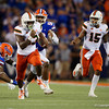 Miami Hurricanes running back DeeJay Dallas (13) breaks a couple tackles and takes it in for a touchdown as the University of Florida Gators hold on to win 24-20 over the University of Miami Hurricanes at Camping World Stadium in Orlando, Florida.  August 23rd, 2019. Gator Country Photo by David Bowie.