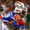 Florida Gators defensive back Jeawon Taylor (29) tackling Miami Hurricanes tight end Brevin Jordan (9) as the University of Florida Gators hold on to win 24-20 over the University of Miami Hurricanes at Camping World Stadium in Orlando, Florida.  August 23rd, 2019. Gator Country Photo by David Bowie.