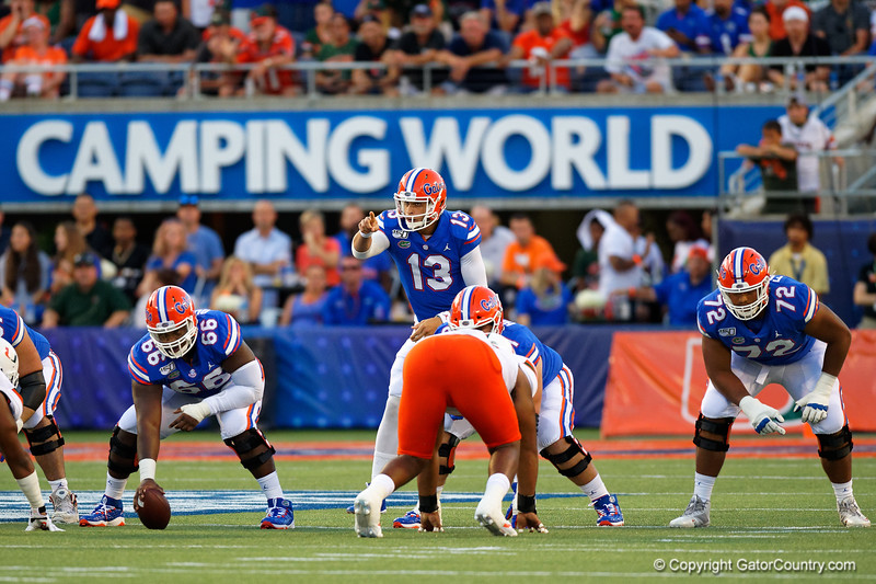 Florida Gators quarterback Feleipe Franks (13) at the line of scrimmage as the University of Florida Gators hold on to win 24-20 over the University of Miami Hurricanes at Camping World Stadium in Orlando, Florida.  August 23rd, 2019. Gator Country Photo by David Bowie.