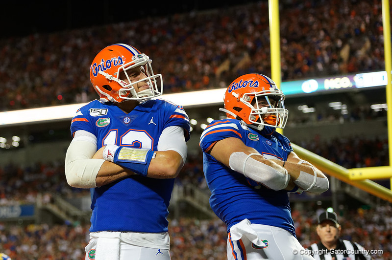 Florida Gators quarterback Feleipe Franks (13) rushes into the endzone to put the Gators up 24-20 as the University of Florida Gators hold on to win 24-20 over the University of Miami Hurricanes at Camping World Stadium in Orlando, Florida.  August 23rd, 2019. Gator Country Photo by David Bowie.