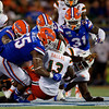 Miami Hurricanes running back DeeJay Dallas (13) is tackled by half of the Gators defense as the University of Florida Gators hold on to win 24-20 over the University of Miami Hurricanes at Camping World Stadium in Orlando, Florida.  August 23rd, 2019. Gator Country Photo by David Bowie.
