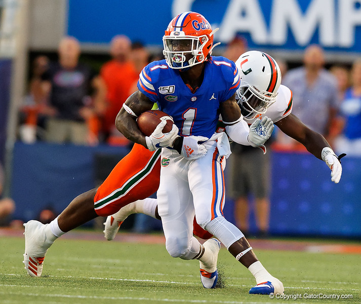 Florida Gators wide receiver Kadarius Toney (1) makes a catch and turns upfield as the University of Florida Gators hold on to win 24-20 over the University of Miami Hurricanes at Camping World Stadium in Orlando, Florida.  August 23rd, 2019. Gator Country Photo by David Bowie.