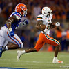 Miami Hurricanes wide receiver Mike Harley (3) makes a catch as the University of Florida Gators hold on to win 24-20 over the University of Miami Hurricanes at Camping World Stadium in Orlando, Florida.  August 23rd, 2019. Gator Country Photo by David Bowie.