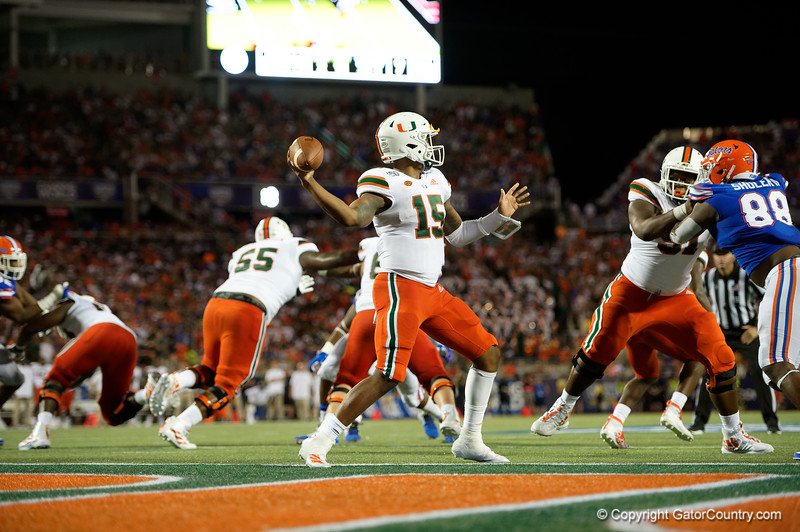 Miami Hurricanes quarterback Jarren Williams (15) throwing as the University of Florida Gators hold on to win 24-20 over the University of Miami Hurricanes at Camping World Stadium in Orlando, Florida.  August 23rd, 2019. Gator Country Photo by David Bowie.
