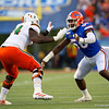 Florida Gators linebacker Jonathan Greenard (58) ateempts to avoid a block as the University of Florida Gators hold on to win 24-20 over the University of Miami Hurricanes at Camping World Stadium in Orlando, Florida.  August 23rd, 2019. Gator Country Photo by David Bowie.