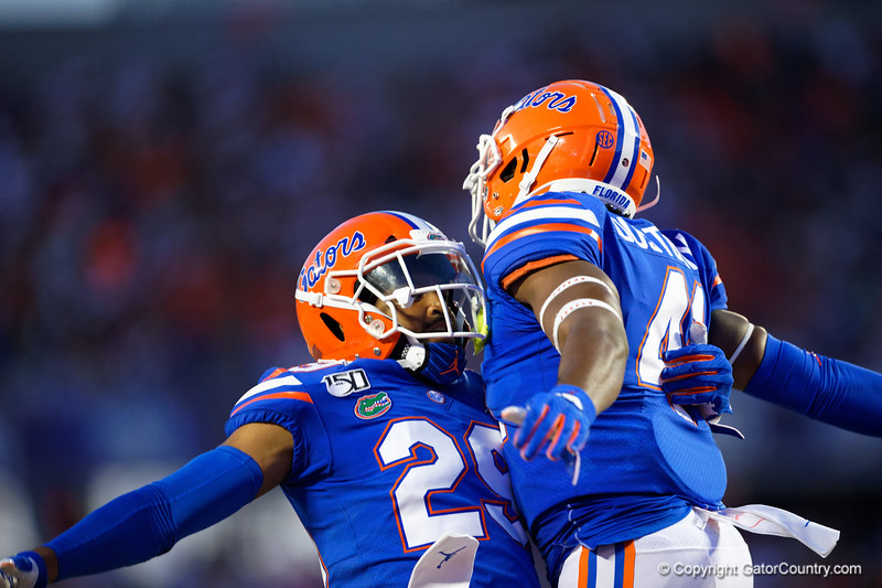 Florida Gators defensive back Jeawon Taylor (29) and Florida Gators linebacker James Houston IV (41) as the University of Florida Gators hold on to win 24-20 over the University of Miami Hurricanes at Camping World Stadium in Orlando, Florida.  August 23rd, 2019. Gator Country Photo by David Bowie.