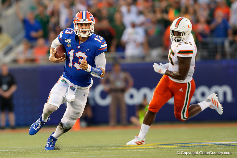 Florida Gators quarterback Feleipe Franks (13) scrambles upfield as the University of Florida Gators hold on to win 24-20 over the University of Miami Hurricanes at Camping World Stadium in Orlando, Florida.  August 23rd, 2019. Gator Country Photo by David Bowie.