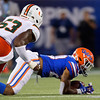Florida Gators running back Malik Davis (20) jumps on fumbled ball but is unable to recover it as the University of Florida Gators hold on to win 24-20 over the University of Miami Hurricanes at Camping World Stadium in Orlando, Florida.  August 23rd, 2019. Gator Country Photo by David Bowie.