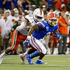 Florida Gators running back Lamical Perine (2) is tackled by Miami Hurricanes linebacker Shaquille Quarterman (55) as the University of Florida Gators hold on to win 24-20 over the University of Miami Hurricanes at Camping World Stadium in Orlando, Florida.  August 23rd, 2019. Gator Country Photo by David Bowie.