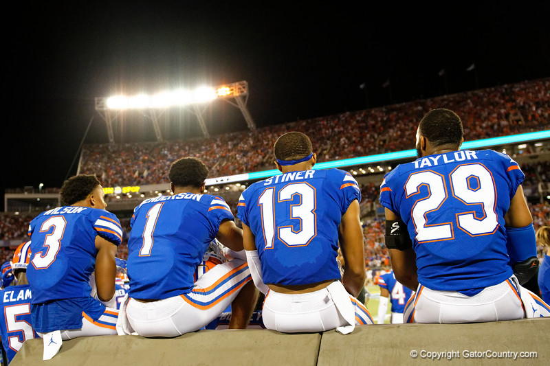 Florida Gators defensive back Marco Wilson (3),Florida Gators defensive back CJ Henderson (1),Florida Gators defensive back Donovan Stiner (13),Florida Gators defensive back Jeawon Taylor (29) as the University of Florida Gators hold on to win 24-20 over the University of Miami Hurricanes at Camping World Stadium in Orlando, Florida.  August 23rd, 2019. Gator Country Photo by David Bowie.
