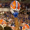 A florida Gators helmet is raised into the air as the University of Florida Gators celebrate after holding on to win 24-20 over the University of Miami Hurricanes at Camping World Stadium in Orlando, Florida.  August 23rd, 2019. Gator Country Photo by David Bowie.