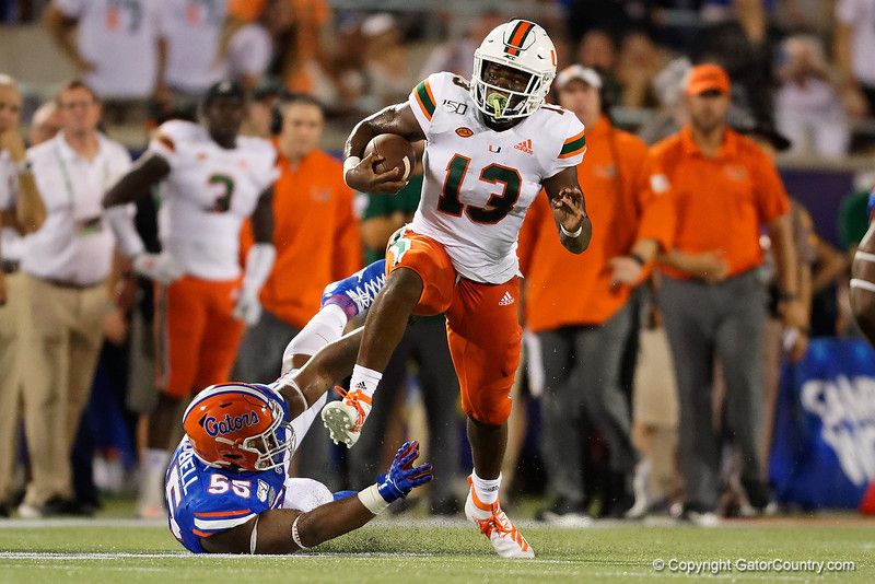 Miami Hurricanes running back DeeJay Dallas (13) rushing as the University of Florida Gators hold on to win 24-20 over the University of Miami Hurricanes at Camping World Stadium in Orlando, Florida.  August 23rd, 2019. Gator Country Photo by David Bowie.