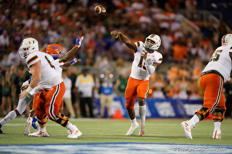Miami Hurricanes quarterback Jarren Williams (15) throws downfield as the University of Florida Gators hold on to win 24-20 over the University of Miami Hurricanes at Camping World Stadium in Orlando, Florida.  August 23rd, 2019. Gator Country Photo by David Bowie.