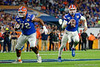 Florida Gators quarterback Kyle Trask (11) scrambles out of the pocket and throws downfield as the Florida Gators take on the Virginia Cavaliers in the 2019 Capital One Orange Bowl in Miami Gardens, Florida.  December 30th, 2019. Gator Country Photo by David Bowie.