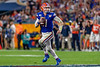 Florida Gators quarterback Kyle Trask (11) scrambling as the Florida Gators take on the Virginia Cavaliers in the 2019 Capital One Orange Bowl in Miami Gardens, Florida.  December 30th, 2019. Gator Country Photo by David Bowie.