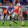 Florida Gators quarterback Kyle Trask (11) scrambles out of the pocket as the Florida Gators take on the Virginia Cavaliers in the 2019 Capital One Orange Bowl in Miami Gardens, Florida.  December 30th, 2019. Gator Country Photo by David Bowie.