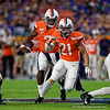 Virginia Cavaliers quarterback Bryce Perkins (3) rushes downfield with Virginia Cavaliers running back Wayne Taulapapa (21) blocking as the Florida Gators take on the Virginia Cavaliers in the 2019 Capital One Orange Bowl in Miami Gardens, Florida.  December 30th, 2019. Gator Country Photo by David Bowie.