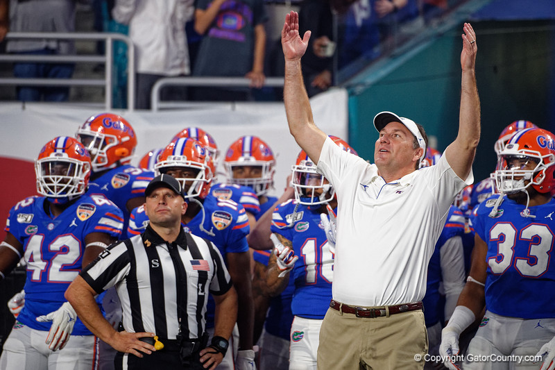 Florida Gators head coach Dan Mullen as the Florida Gators run onto the field prior to kickoff in the 2019 Capital One Orange Bowl in Miami Gardens, Florida.  December 30th, 2019. Gator Country Photo by David Bowie.