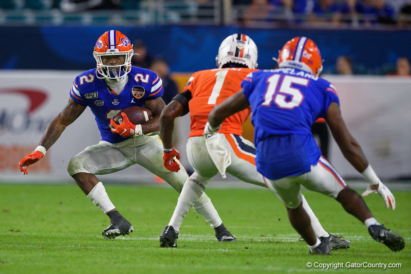 Florida Gators running back Lamical Perine (2) rushing as the Florida Gators take on the Virginia Cavaliers in the 2019 Capital One Orange Bowl in Miami Gardens, Florida.  December 30th, 2019. Gator Country Photo by David Bowie.
