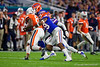 Florida Gators defensive back Jeawon Taylor (29) tackling Virginia Cavaliers wide receiver Hasise Dubois (8) as the Florida Gators take on the Virginia Cavaliers in the 2019 Capital One Orange Bowl in Miami Gardens, Florida.  December 30th, 2019. Gator Country Photo by David Bowie.