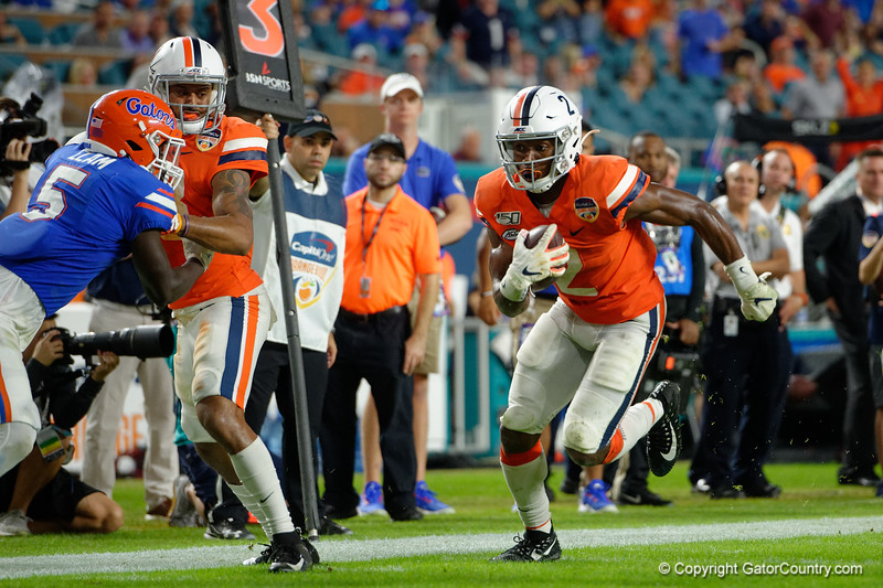 Virginia Cavaliers wide receiver Joe Reed (2) catches a pass and runs the ball into the endzone as the Florida Gators take on the Virginia Cavaliers in the 2019 Capital One Orange Bowl in Miami Gardens, Florida.  December 30th, 2019. Gator Country Photo by David Bowie.