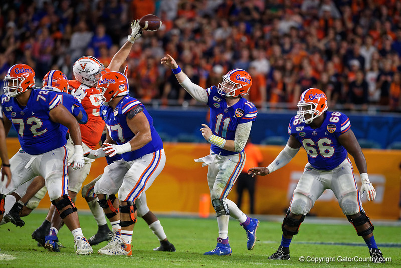 Florida Gators quarterback Kyle Trask (11) throwing as the Florida Gators take on the Virginia Cavaliers in the 2019 Capital One Orange Bowl in Miami Gardens, Florida.  December 30th, 2019. Gator Country Photo by David Bowie.