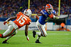 Florida Gators running back Lamical Perine (2) rushes into the endzone for his second touchdown of the game as the Florida Gators take on the Virginia Cavaliers in the 2019 Capital One Orange Bowl in Miami Gardens, Florida.  December 30th, 2019. Gator Country Photo by David Bowie.
