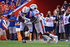Florida Gators tight end Kyle Pitts (84) is hit by Auburn Tigers defensive back Smoke Monday (21) as the Gators defeat the #5 Auburn Tigers 24-13 at Ben Hill Griffin Stadium in Gainesville, Florida on October 5th, 2019 (Photo by David Bowie/Gatorcountry)