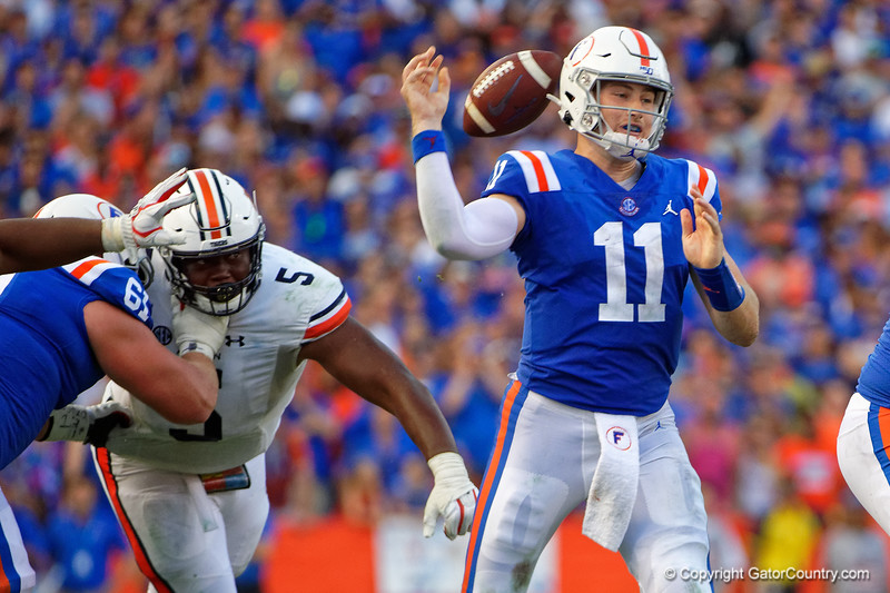 Florida Gators quarterback Kyle Trask (11) has the ball stripped away by Auburn Tigers defensive tackle Derrick Brown (5) as the Gators defeat the #5 Auburn Tigers 24-13 at Ben Hill Griffin Stadium in Gainesville, Florida on October 5th, 2019 (Photo by David Bowie/Gatorcountry)