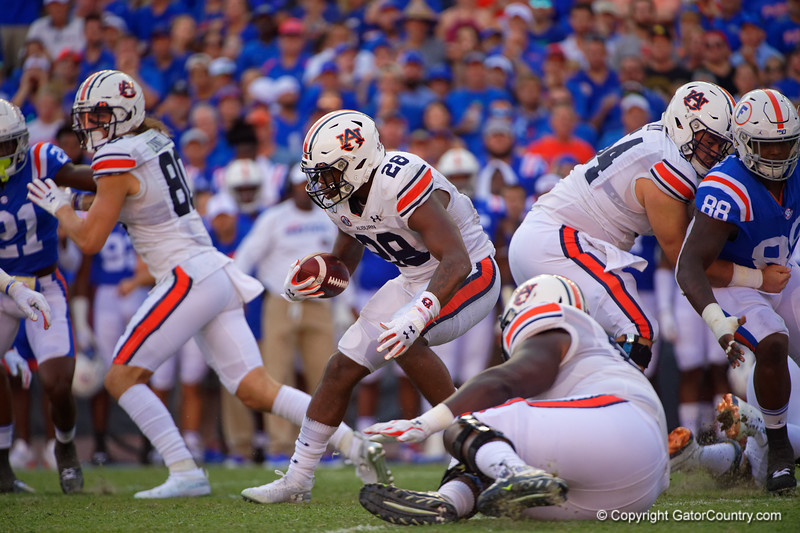 Auburn Tigers running back JaTarvious Whitlow (28) rushing as the Gators defeat the #5 Auburn Tigers 24-13 at Ben Hill Griffin Stadium in Gainesville, Florida on October 5th, 2019 (Photo by David Bowie/Gatorcountry)