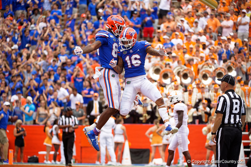Florida Gators wide receiver Freddie Swain (16) and Florida Gators tight end Kyle Pitts (84) celebrate after a touchdown as the Gators defeat SEC East rival the University of Tennessee Volunteers at Ben Hill Griffin Stadium in Gainesville, Florida on September 21st, 2019 (Photo by David Bowie/Gatorcountry)