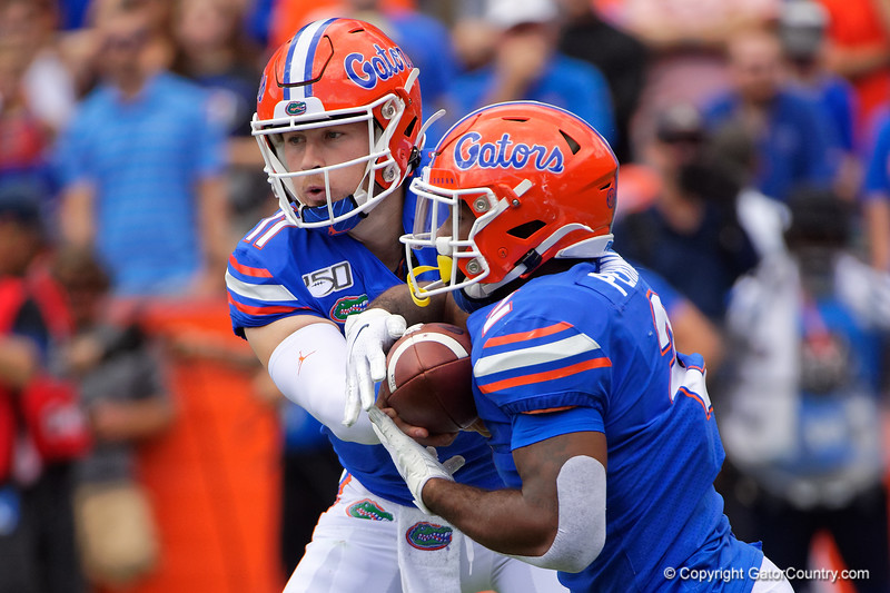 Florida Gators quarterback Kyle Trask (11) hands the ball off to Florida Gators running back Lamical Perine (2) as the Gators defeat SEC East rival the University of Tennessee Volunteers at Ben Hill Griffin Stadium in Gainesville, Florida on September 21st, 2019 (Photo by David Bowie/Gatorcountry)